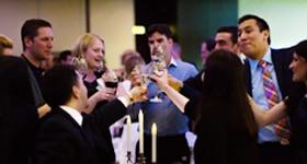 Alumni toasting to the night