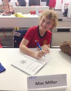 Mac Millar signs books at Hult Shanghai