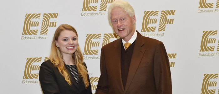 Master of International Marketing candidate, Kathrin Schulbe, shakes hands with the 42nd President of the United States, Bill Clinton, at EF Education First's 50th anniversary celebration