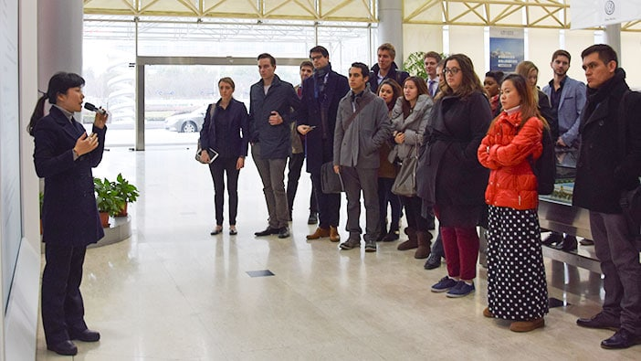 Students listening to the welcome speech at Volkswagen