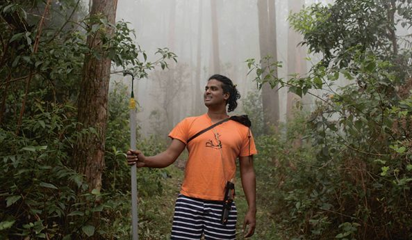 Jacob Cherian photographed in the forest in Kodaikanal, India